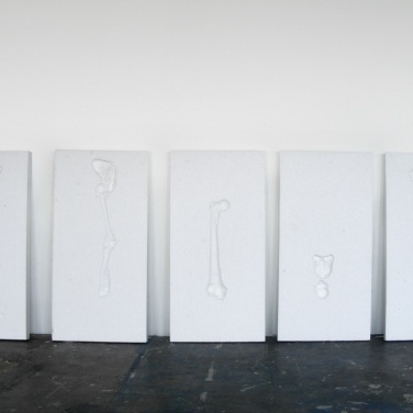 Bones. 2010, installation. Blocks of polystyrene, human bones imprints, 150 x 50 cm /Bones. 2010, installation. Polystyrène, empreintes d'os humains, 150 x 50 cm