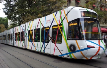 Suprematistisches Tram (Suprematist Train). 2012, train decorated by colored rays. Art in the City, Zürich, temporary installation / Tram Suprématique. 2012, tramway décoré de rayures colorées. Art in the City, Zürich, installation temporaire
